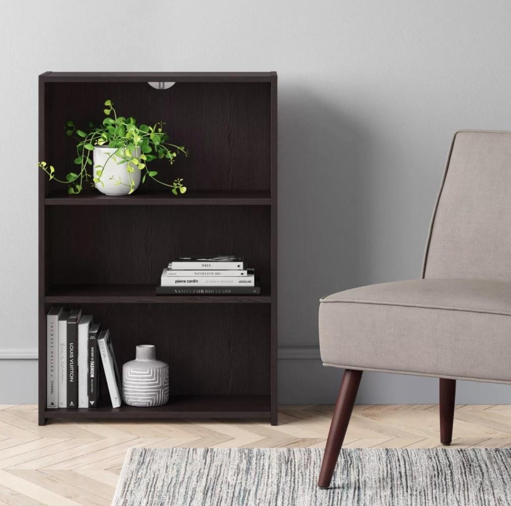A brown three-shelf bookcase