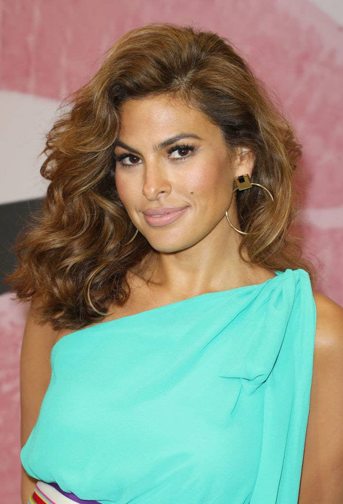 Eva wearing a teal one-shoulder top at an event