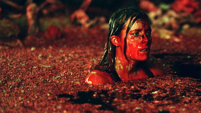 A woman in a cavern filled with blood