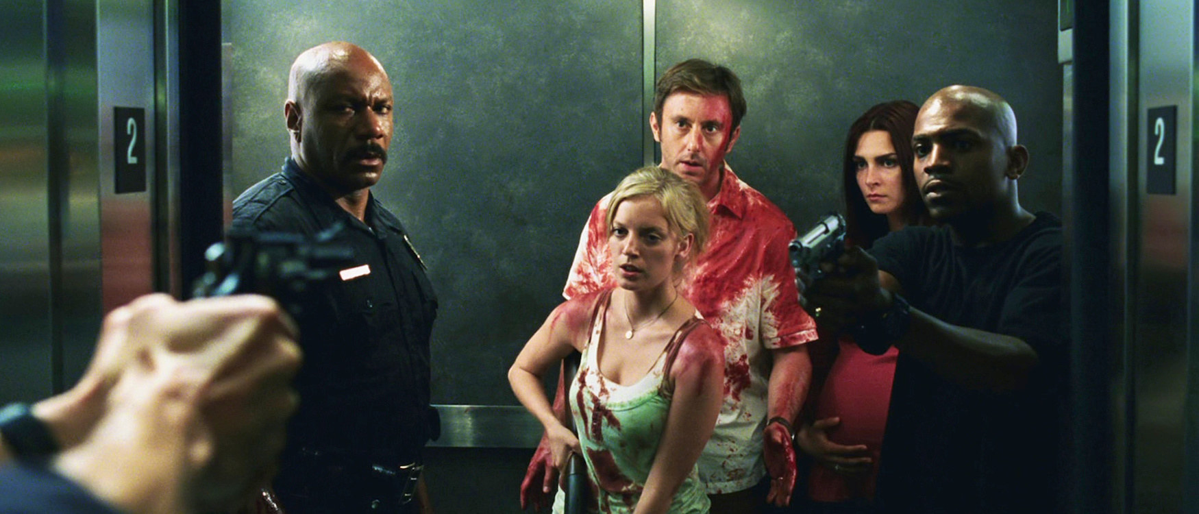 A group of bloodied survivors in an elevator, trying their best to escape the zombie apocalypse