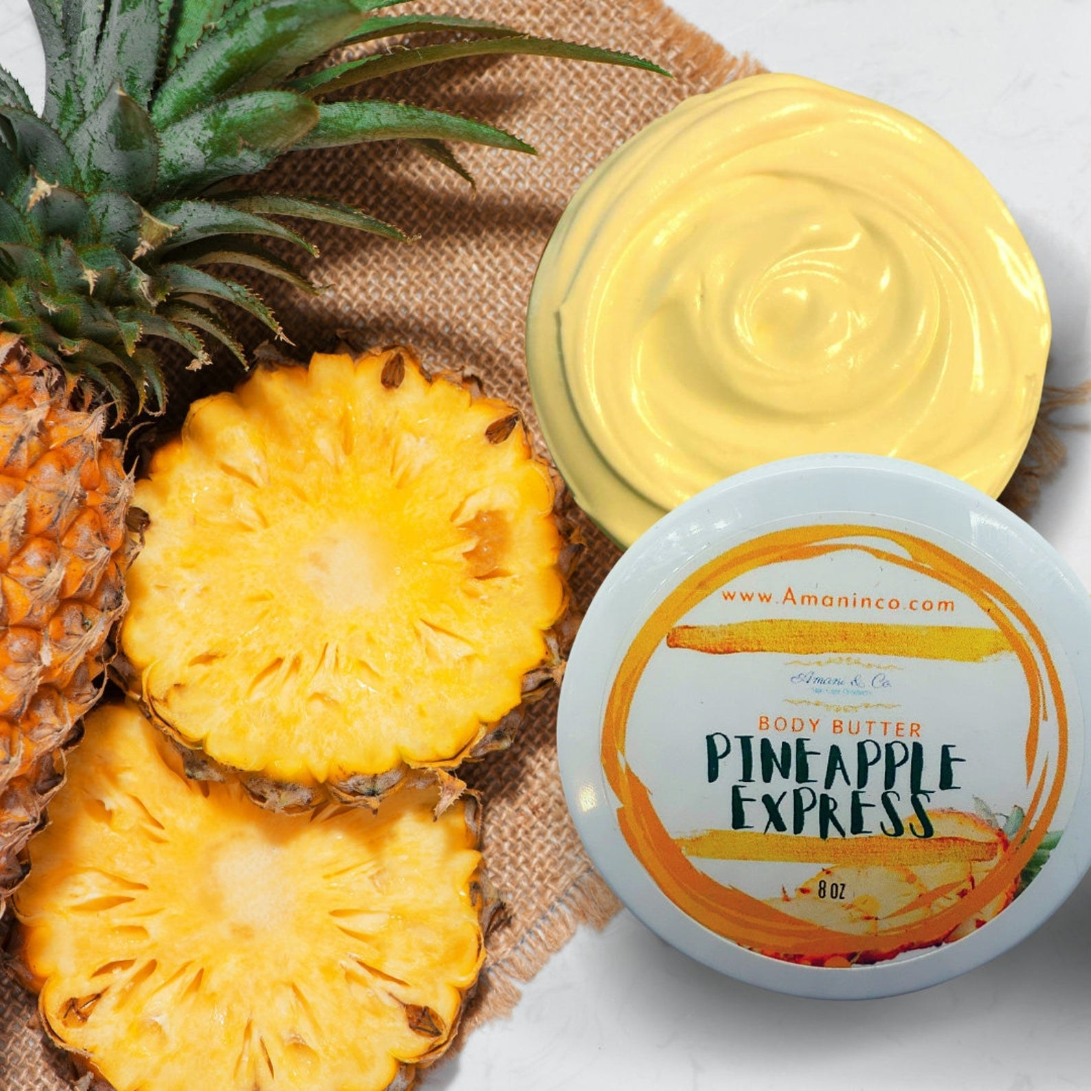 jar of body butter plus slices of a full pineapple