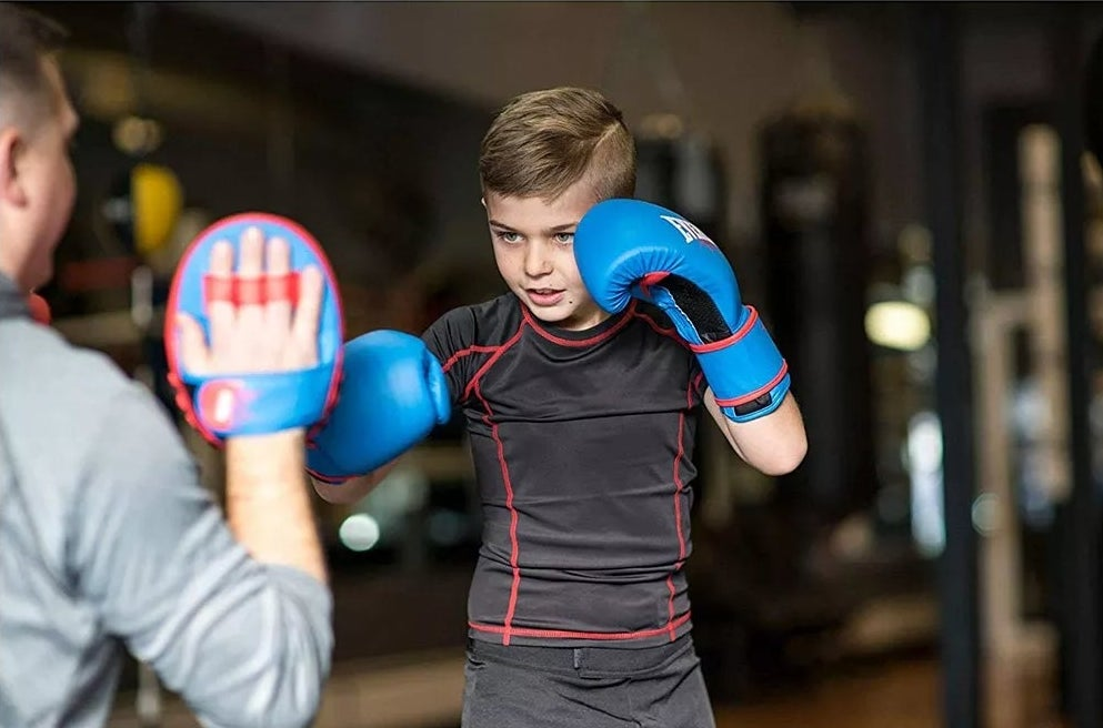 A child sparing with the gloves and mitts