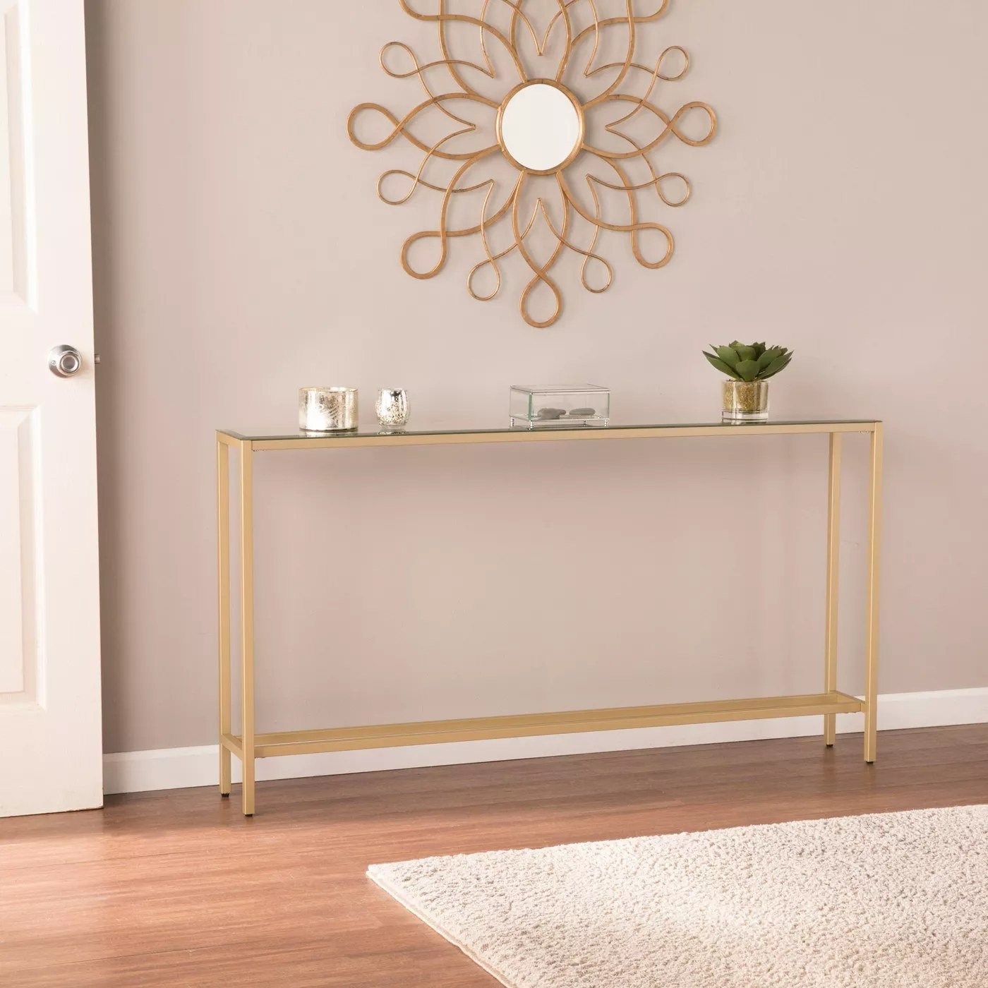 The gold and glass console table