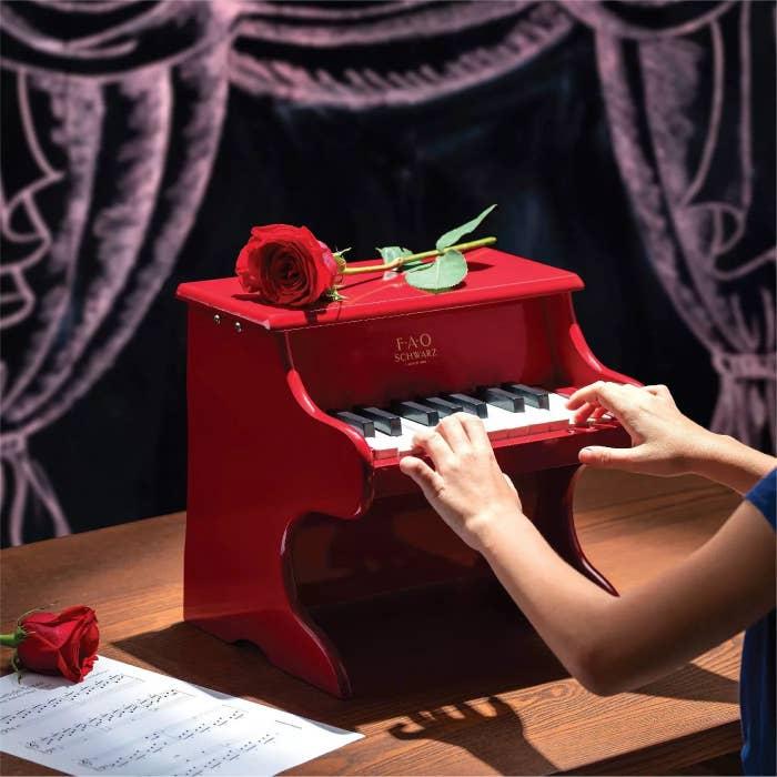 The red FAO Schwartz piano