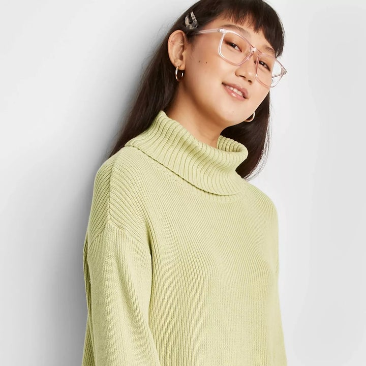 The green pullover sweater with a turtleneck