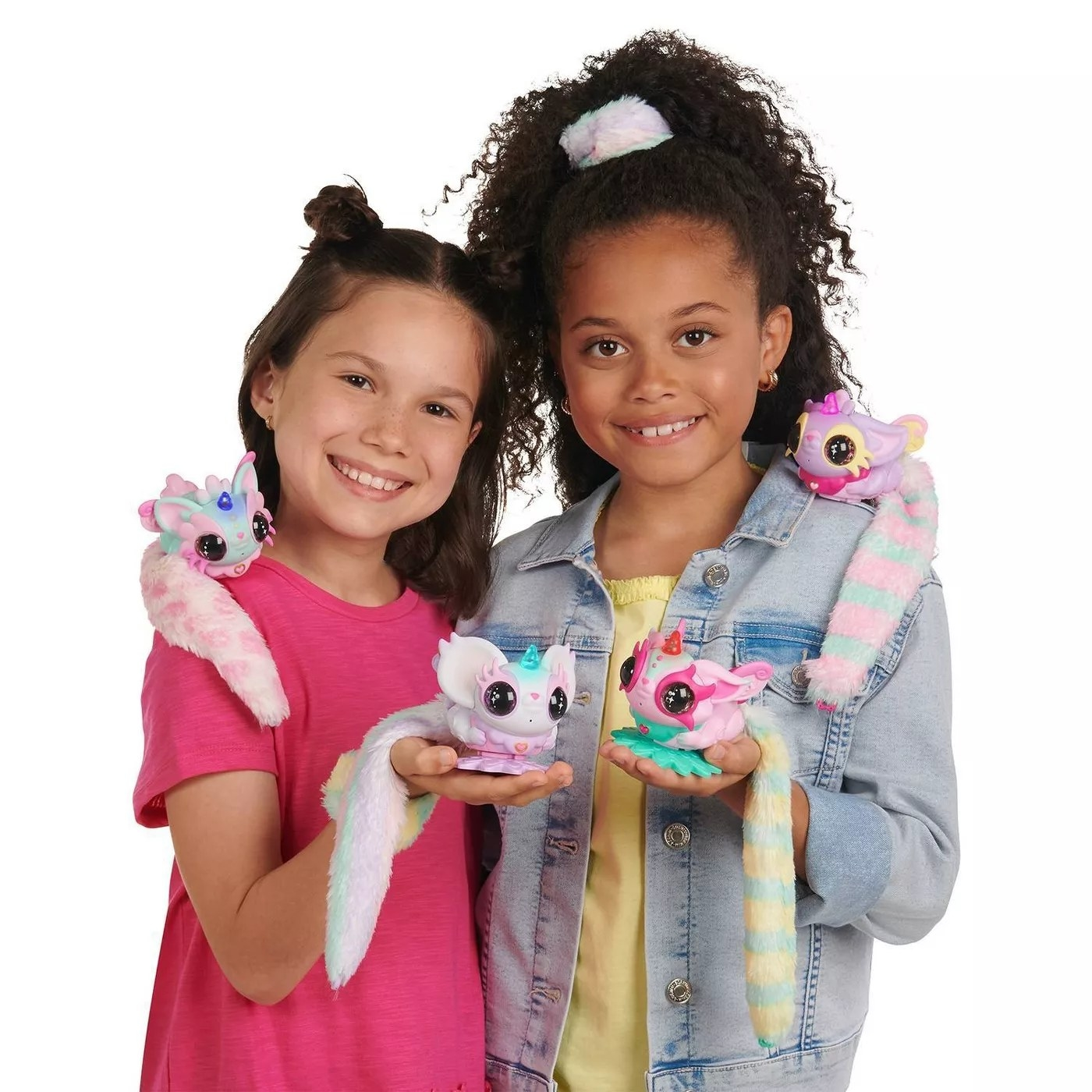 Two kids holding Pixie Belle toys