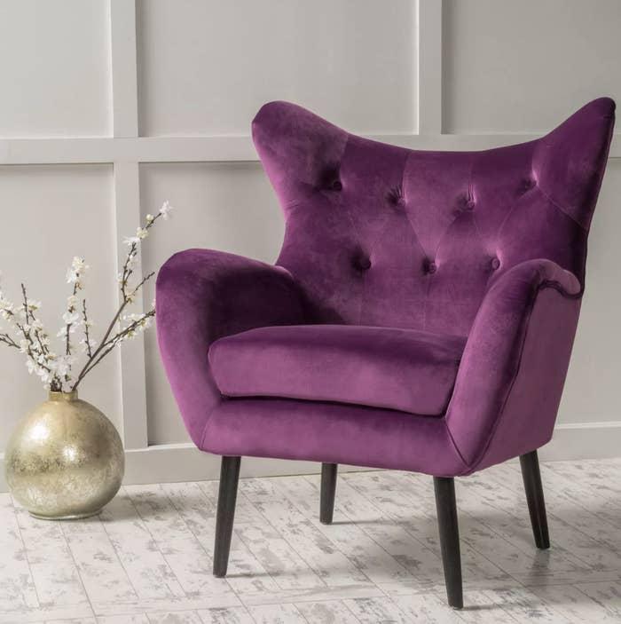 A vibrant purple accent chair