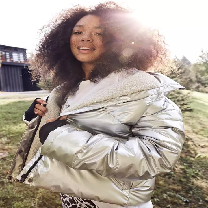 model wearing the silver sherpa puffer