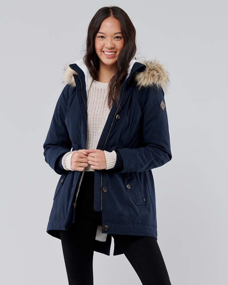 model wearing the blue puffer parka