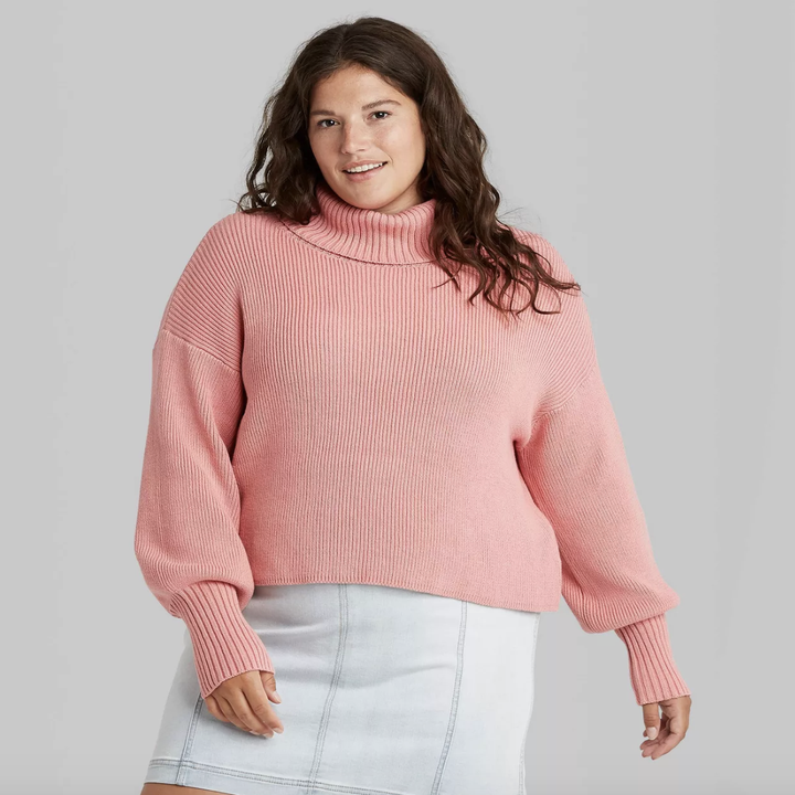 model wearing the pink sweater