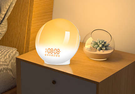 The light alarm clock shining with a warm light on a bedside table next to a succulent