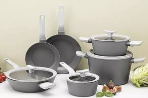 The gray fry pan, covered sautepan, covered saucepan, and two covered stockpots