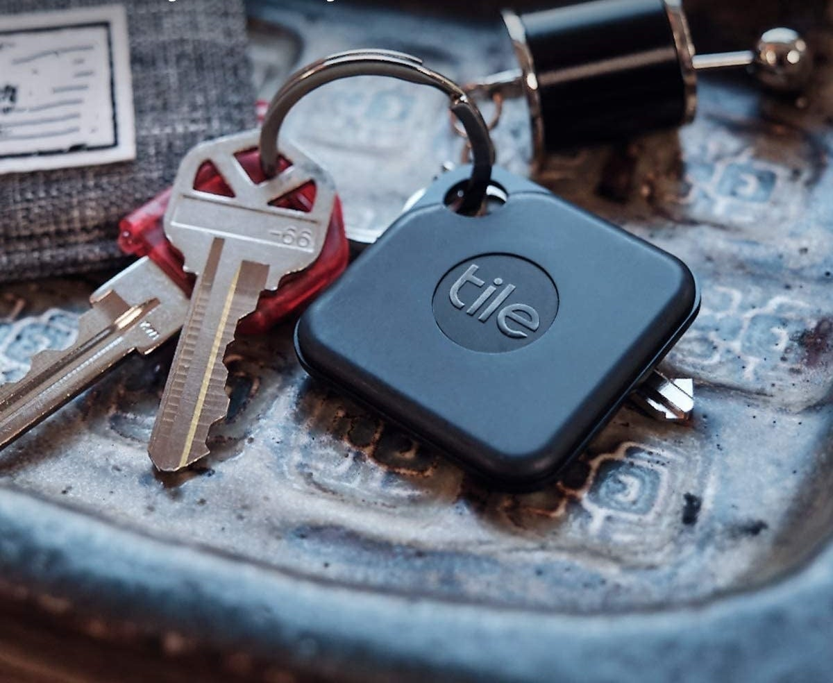 A small square tracking tile attached to a key ring