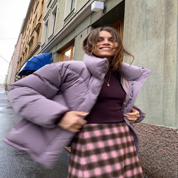 model wearing purple puffer jacket