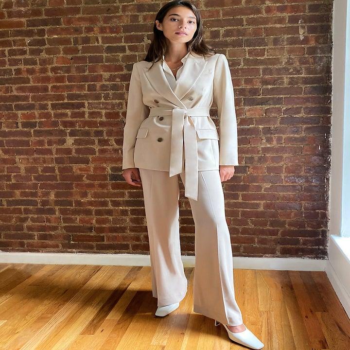 model wearing belted white blazer