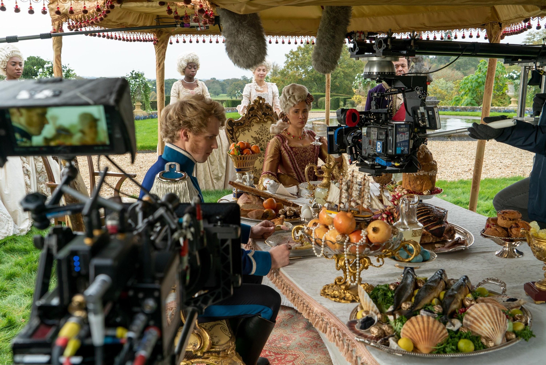 Golda Rosheuvel Freddie Stroma filming a dinner scene outside