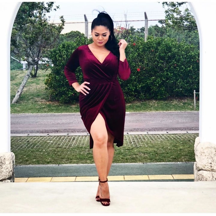Reviewer wearing red dress