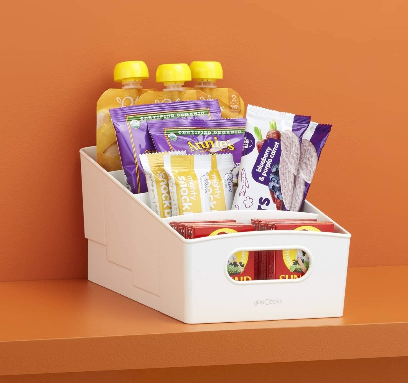 A tiered snack shelf loaded up with sweet treats