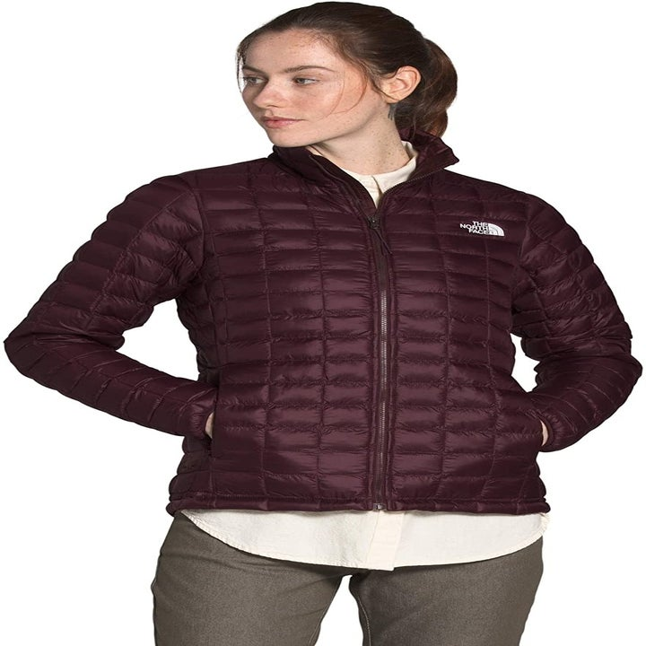Front view of a model wearing the jacket in root brown matte