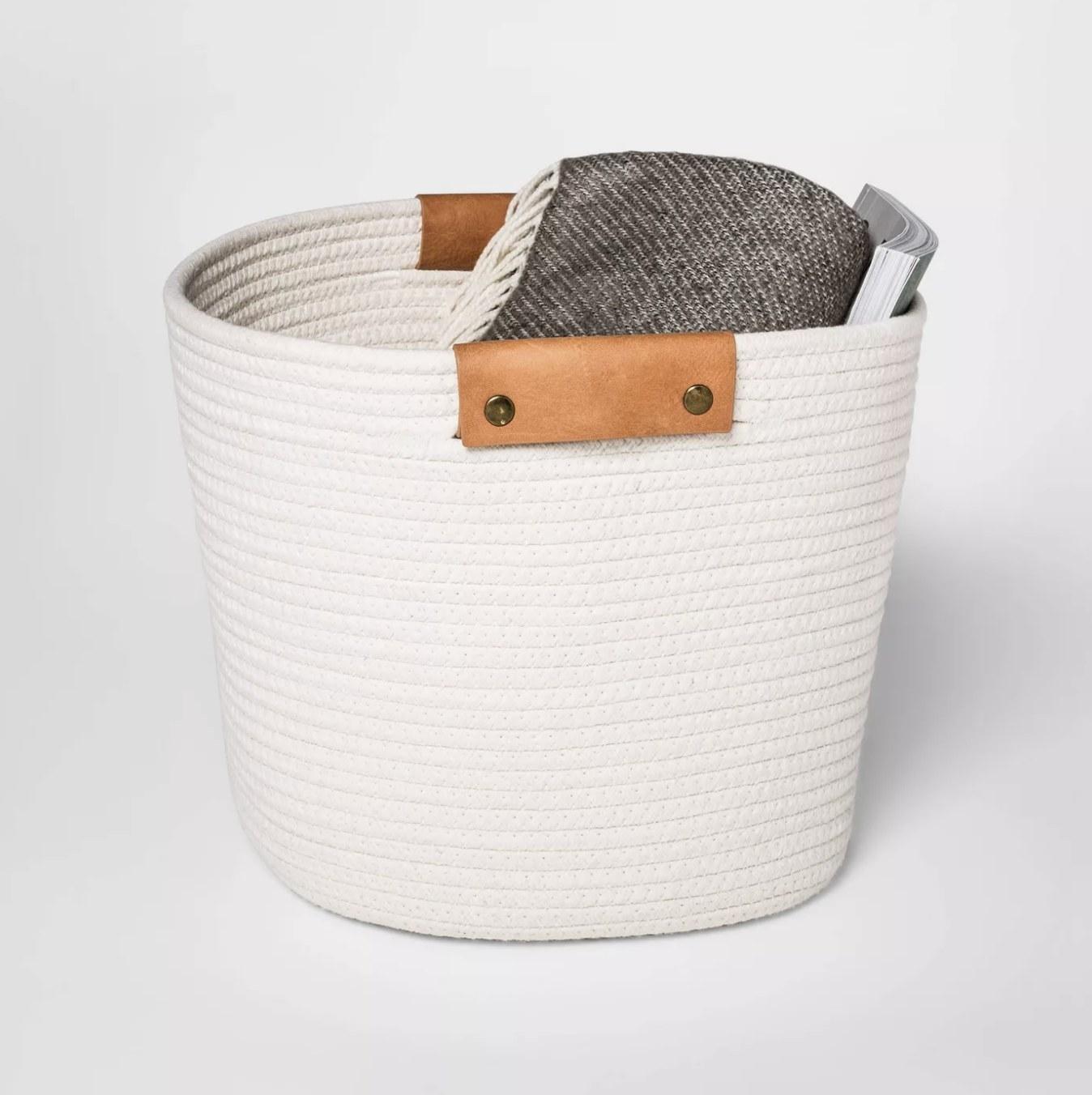 The cream colored basket