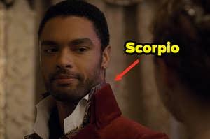 """Simon with an arrow pointing toward with """"scorpio"""" written next to him"""