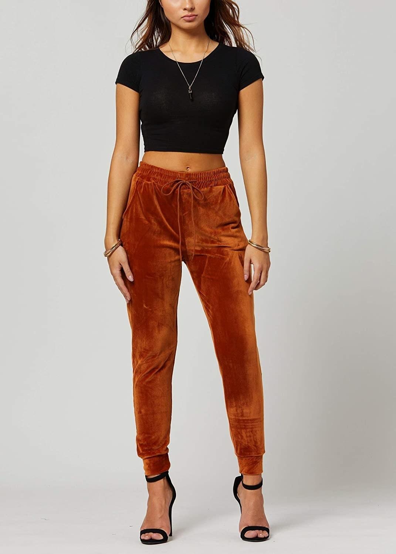 Model wearing velvet joggers