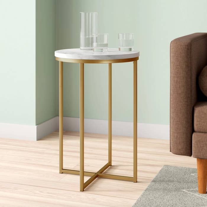 The end table in white and brass