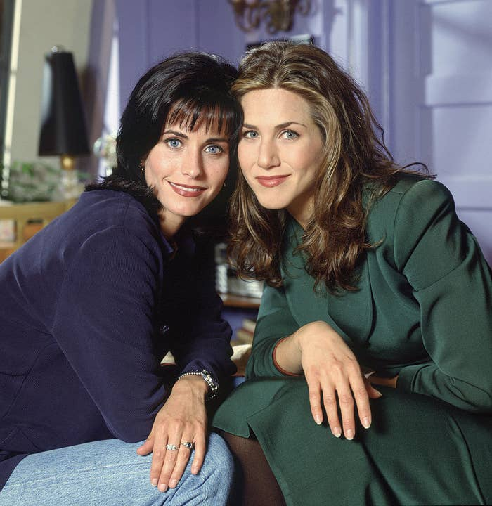 """Courteney Cox and Jennifer Aniston posing as Monica and Rachel on the set of """"Friends"""""""