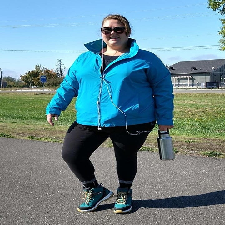 A reviewer wearing the jacket in fjord blue