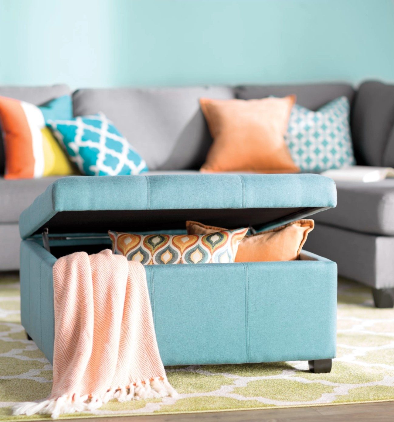 The tufted ottoman in dark teal