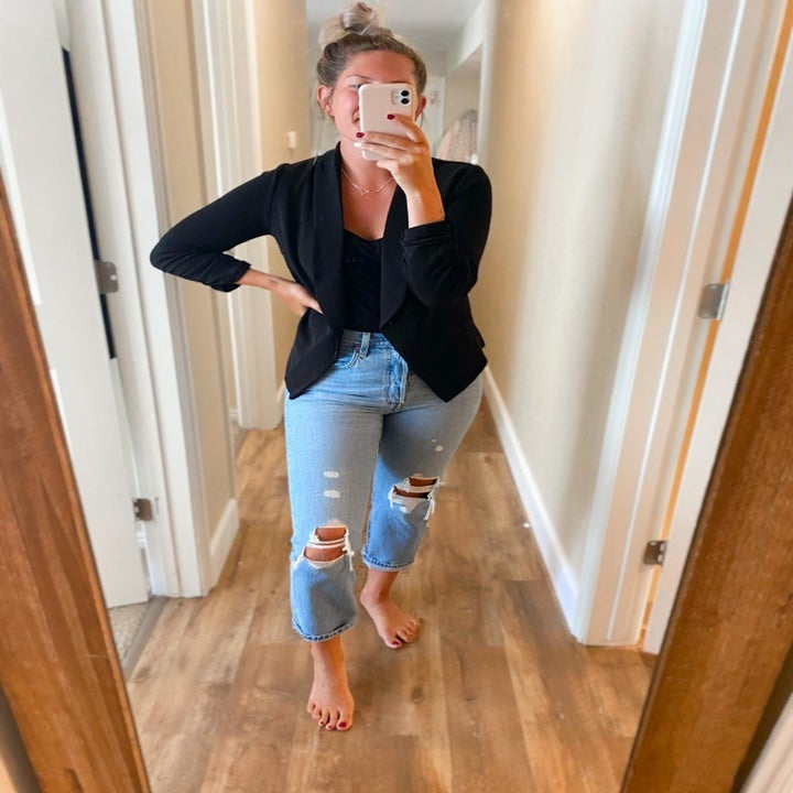 a different reviewer wearing the blazer in black