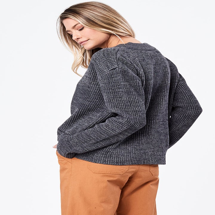 Back view of a model wearing the V-neck sweater in charcoal heather