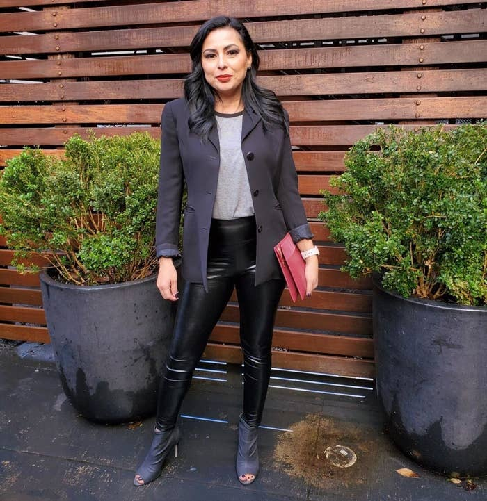 Reviewer wearing faux leather leggings