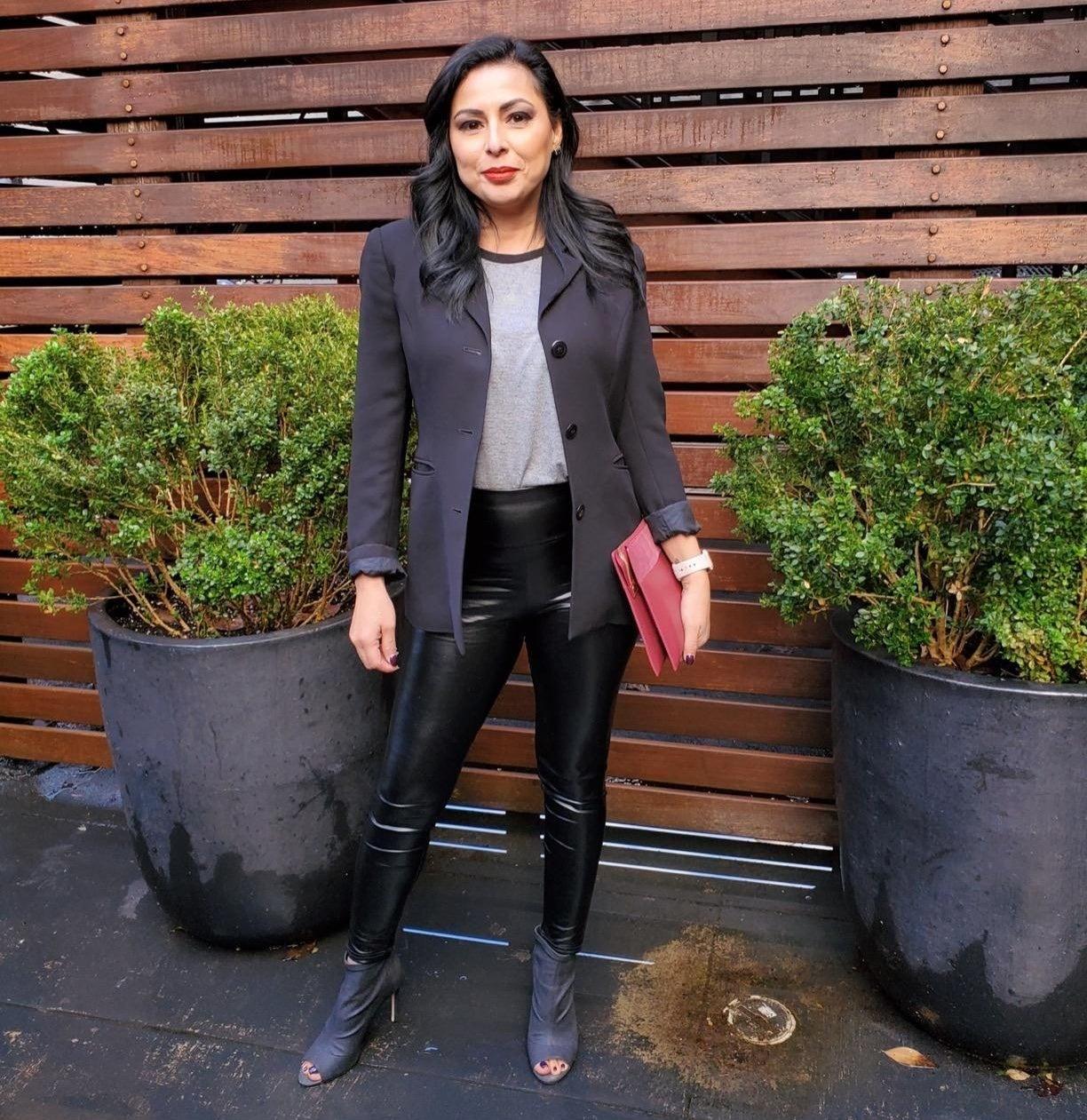 Reviewer wearing faux leather leggings in black