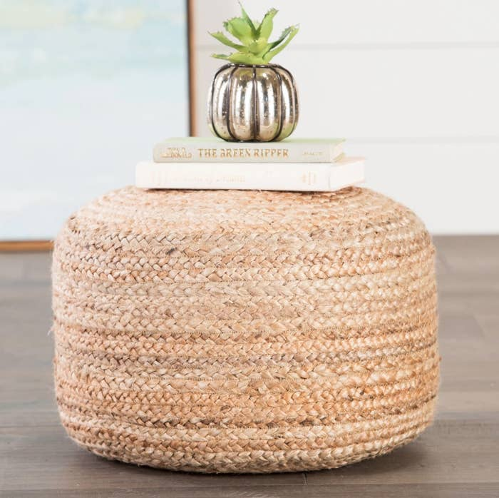 The round pouf ottoman in natural