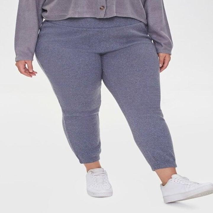 model wearing the purple knit joggers