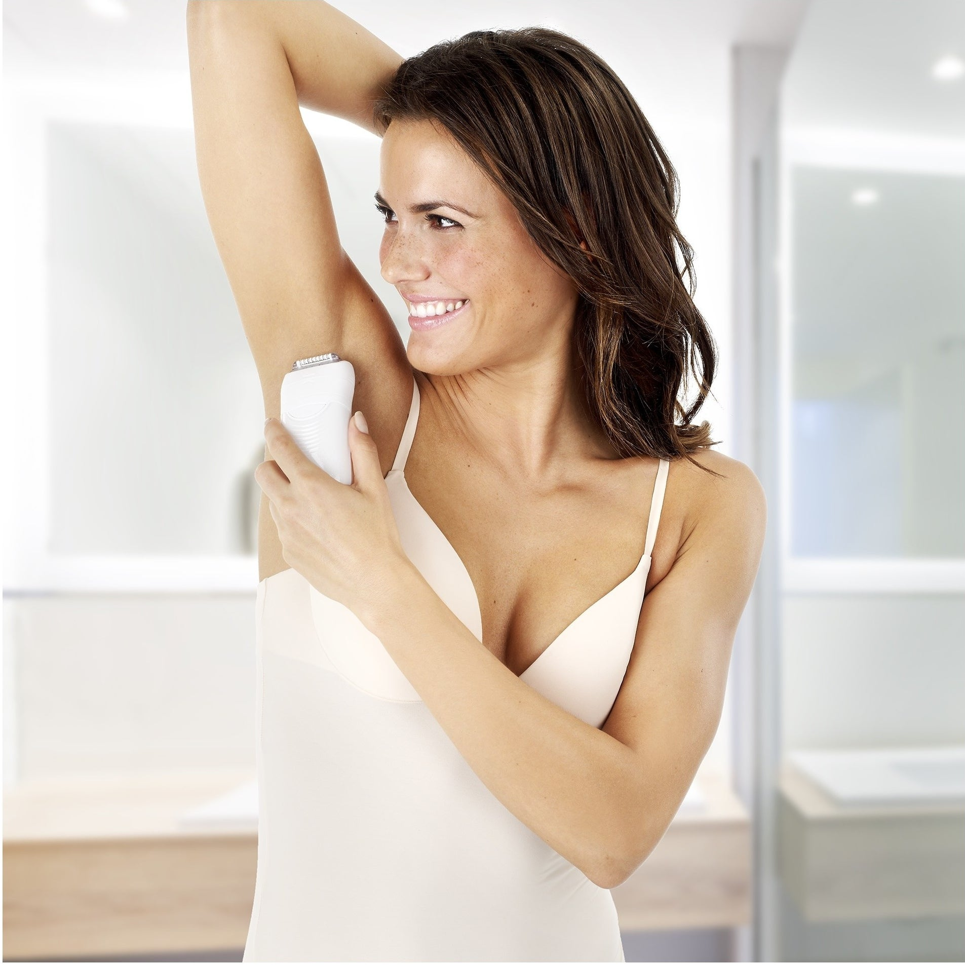 A model using the epilator on the underarms