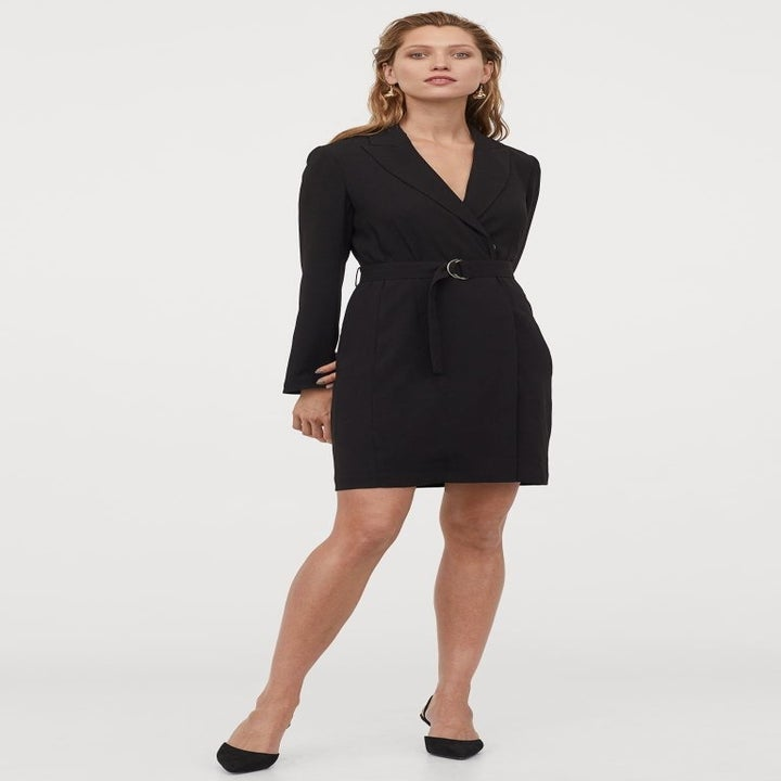 model wearing the black blazer dress