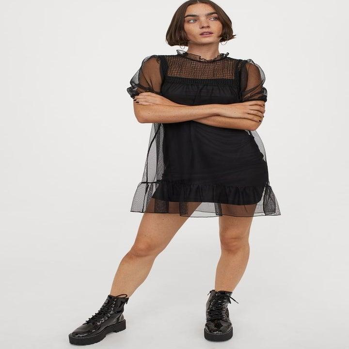 model wearing the black mesh mini dress