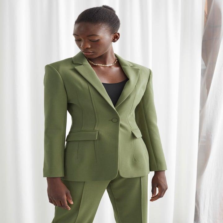 model wearing the green blazer