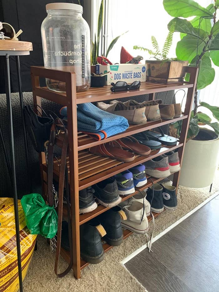 the Homfa Bamboo Shoe Rack in a customer's home storing sneakers