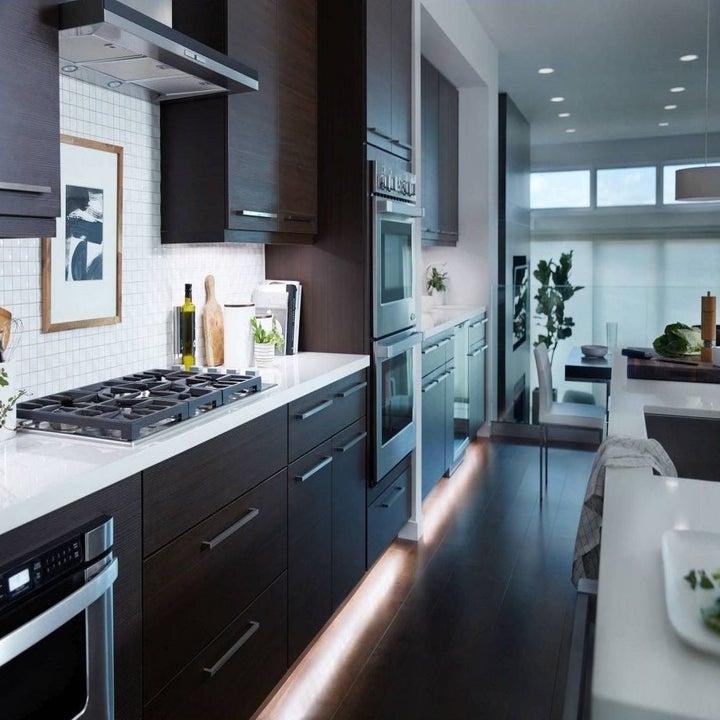 white LED light strips underneath kitchen cabinets