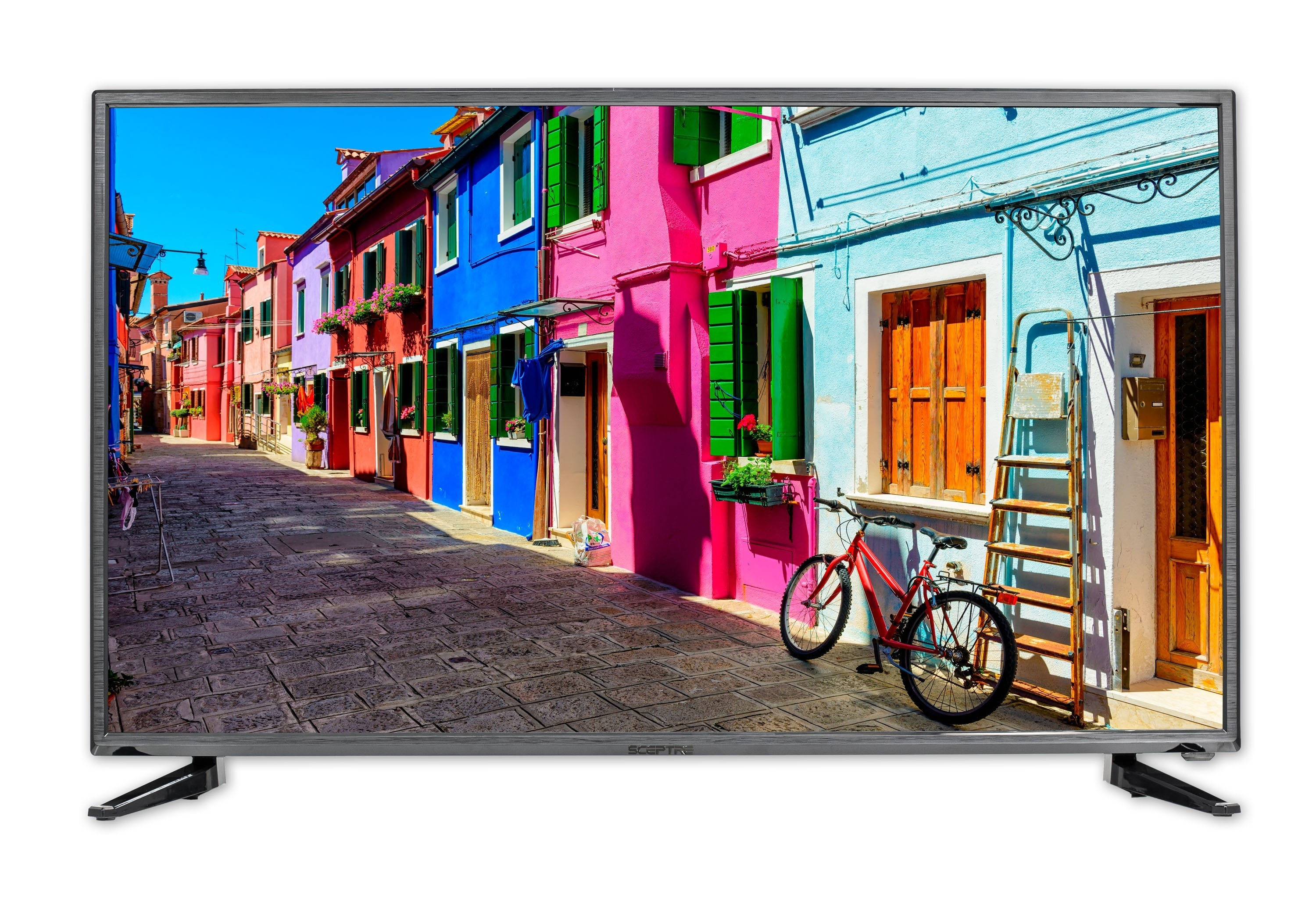 The TV with a brightly colored street scene on the screen