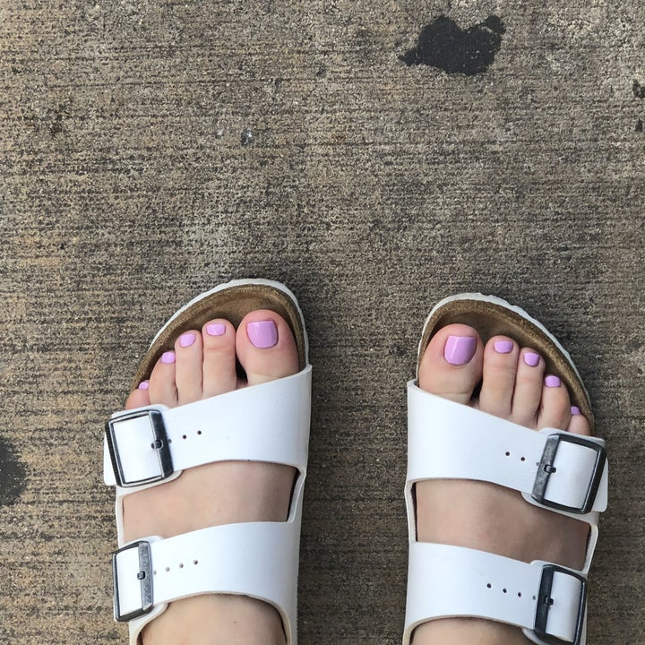 BuzzFeed editor wearing the sandals in white