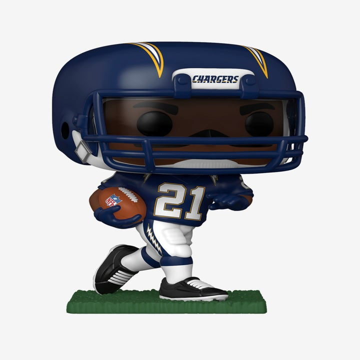 Ladainian Tomlinson in a blue chargers uniform holding a football