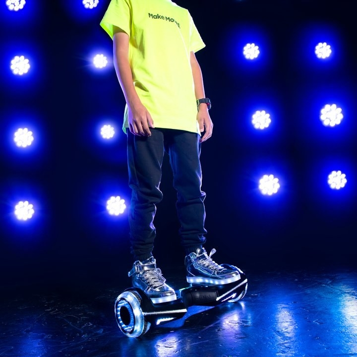 A model riding the lit hoverboard