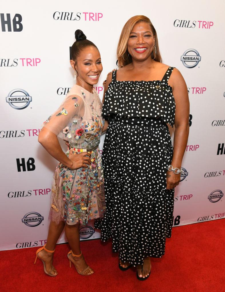 "Jada Pinkett Smith and Queen Latifah happily posing at the ""Girls Trip"" screening in 2017"