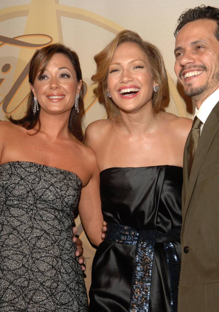 Leah Remini, Jennifer Lopez, and Marc Anthony posing together at the Crystal + Lucy Awards