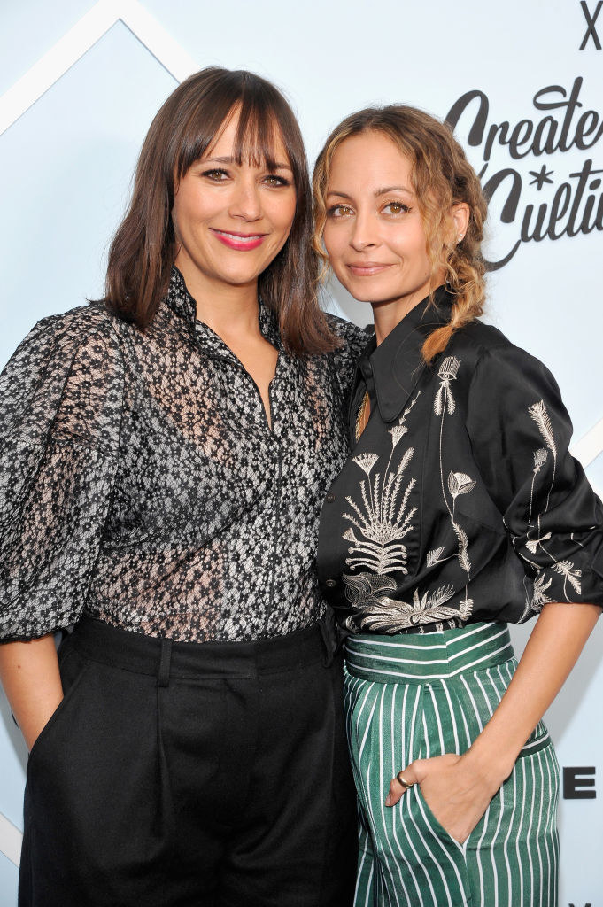 Rashida Jones and Nicole Richie posing on a red carpet together in 2018 at the Beverly Center