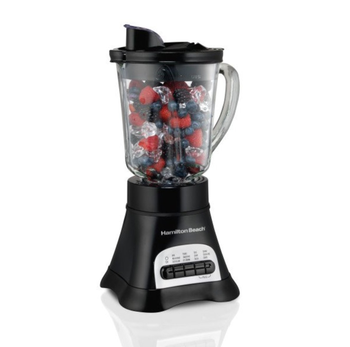 The blender filled with berries